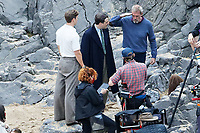 Pictured: Will Poulter and Conieth Hill. Friday 18 June 2021<br /> Re: Film set with a scene being filmed with Hugh Laurie as a director at Three Cliffs Bay in the Gower Peninsula, Wales, UK.