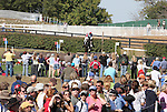 02 October 2010.  Spectators watch as Takayuki Yumira and Hooligan clearjump #24 Horse Park Shelters.