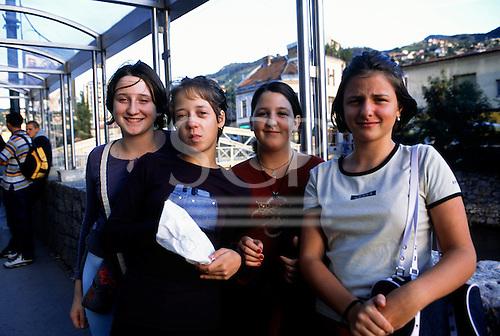 Sarajevo, Bosnia. Four teenage girls beside the river.