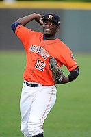 Right fielder Ydarqui Marte (12) of the Greeneville Astros warms up before a game against the Bristol Pirates on Friday, July 25, 2014, at Pioneer Park in Greeneville, Tennessee. Greeneville won, 9-4. (Tom Priddy/Four Seam Images)