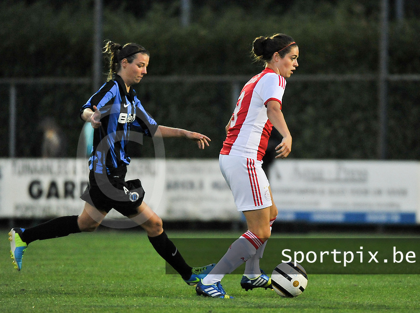20130830 - VARSENARE , BELGIUM : Ajax' Tessel Middag (right) on the ball before Brugge's Nicky Van Den Abbeele (left) pictured during the female soccer match between Club Brugge Vrouwen and Ajax Amsterdam Dames , of the first matchday in the BENELEAGUE competition. Friday 30 August 2013. PHOTO DAVID CATRY