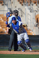 Mesa Solar Sox catcher Willson Contreras (40) looks for a blocked ball in front of umpire Ryan Blakney during an Arizona Fall League game against the Glendale Desert Dogs on October 13, 2015 at Camelback Ranch in Glendale, Arizona.  Glendale defeated Mesa 8-7.  (Mike Janes/Four Seam Images)