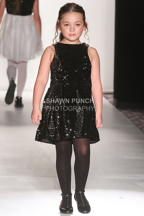"Model walks runway in an outfit from Michelle Ann Fall Winter 2015 ""Glimmerati"" collection by Michelle Ann, during the Designer's Collective Fall Winter 2015 fashion show for  Fashion Gallery New York Fashion Week Fall 2015."