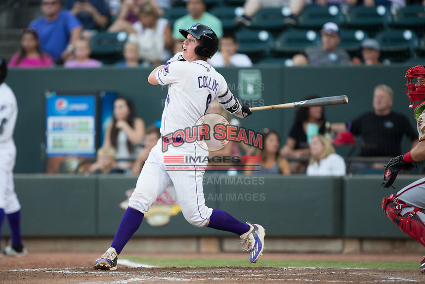 Zack Collins (8) of the Winston-Salem Dash follows through on his swing against the Potomac Nationals at BB&T Ballpark on August 5, 2017 in Winston-Salem, North Carolina.  The Dash defeated the Nationals 6-0.  (Brian Westerholt/Four Seam Images)