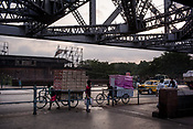 Traffic moves along the Howrah bridge in Howrah, Kolkata, West Bengal  on Friday, May 26, 2017. Photographer: Sanjit Das