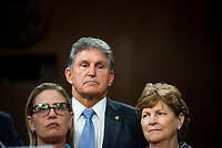 United States Senator Kyrsten Sinema (Democrat of Arizona), left, United States Senator Joe Manchin III (Democrat of West Virginia), center, and United States Senator Jeanne Shaheen (Democrat of New Hampshire) listen as United States Senator Rob Portman (Republican of Ohio) makes remarks after the vote on the motion to invoke cloture to proceed to the consideration of H.R. 3684, the INVEST in America Act on Capitol Hill in Washington, DC on Wednesday, July 28, 2021. The vote to begin discussion of the bipartisan infrastructure bill agreed to by the White House, was 67 to 32. If passed, the bill would invest close to $1 trillion in roads, bridges, ports and other infrastructure without a major tax increase.<br /> Credit: Rod Lamkey / CNP / MediaPunch