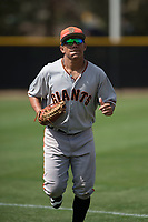 San Francisco Giants left fielder Ismael Munguia (12) jogs off the field between innings of a Minor League Spring Training game against the Cleveland Indians at the San Francisco Giants Training Complex on March 14, 2018 in Scottsdale, Arizona. (Zachary Lucy/Four Seam Images)