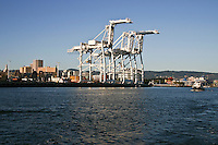 The cranes at the Port of Oakland as seen from the water in San Francisco Bay.