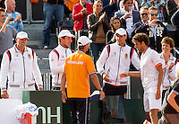 15-09-12, Netherlands, Amsterdam, Tennis, Daviscup Netherlands-Suisse, Doubles, Robin Haase is being congratulated bin his team members.