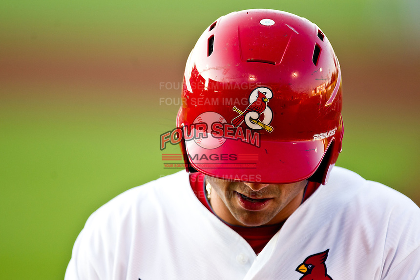 A member of the Springfield Cardinals walks back to the dugout with his batting helmet on during a game against the Arkansas Travelers at Hammons Field on May 5, 2012 in Springfield, Missouri. (David Welker/Four Seam Images)