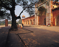 Shadowed cloistered walkway along the side of the great palace and musoleum of Sikandra, near Agra, Indi
