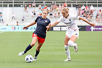 CARY, NC - APRIL 10: Ashley Sanchez #10 of the Washington Spirit tries to push past Schuyler Debree #15 of the North Carolina Courage during a game between Washington Spirit and North Carolina Courage at Sahlen's Stadium at WakeMed Soccer Park on April 10, 2021 in Cary, North Carolina.