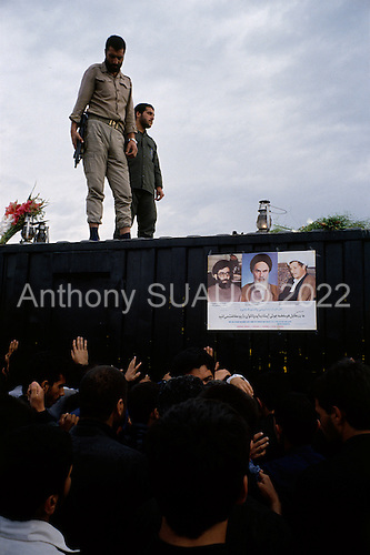 """Tehran, Iran .June 7, 1989..Hundreds of mourners visit and touch the tomb  of the Grand Ayatullah Sayid Ruhullah Musawi Khomeini in the Beheht-E-Zahra cemetery the morning following his funeral. Flowers are dropped by helicopters from above and women have soldiers guarding the tomb touch their babies to it's walls as a blessing. He died of heart attack on June 3, 1989...Khomeini was a senior Shi`i Muslim cleric, Islamic philosopher and marja (religious authority), and the political leader of the 1979 Iranian Revolution that saw the overthrow of Mohammad Reza Pahlavi, the last Shah of Iran. Following the revolution, Khomeini became the country's Supreme Leader?the paramount political figure of the new Islamic Republic...Khomeini was a marja al-taqlid, (source of imitation) and important spiritual leader to many Shia Muslims. He was also an innovative Islamic political theorist, most noted for his development of the theory of velayat-e faqih, the """"guardianship of the jurisconsult (clerical authority)"""". He was named Time's Man of the Year in 1979 and also one of Time magazine's 100 most influential people of the 20th century."""