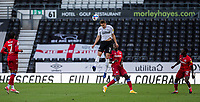 12th September 2020; Pride Park, Derby, East Midlands; English Championship Football, Derby County versus Reading; Craig Forsyth of Derby County jumps to head the ball down the pitch