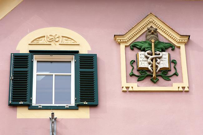 Baroque window and apocathary crest on a house Hartberg Austria