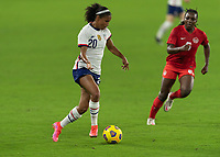 ORLANDO CITY, FL - FEBRUARY 18: Margaret Purce #20 dribbles the ball away from Deanna Rose #6 during a game between Canada and USWNT at Exploria stadium on February 18, 2021 in Orlando City, Florida.