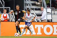 14 MAY 2011: USA Women's National Team midfielder Carli Lloyd (10) dribbles the ball by Japan National team Rumi Utsugi during the International Friendly soccer match between Japan WNT vs USA WNT at Crew Stadium in Columbus, Ohio.