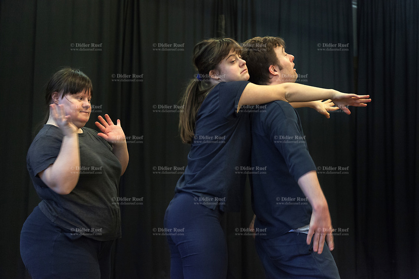 Switzerland. Canton Ticino. Locarno. Fauni Theater.  MOPS_DanceSyndrome is an independent Swiss artistic, cultural and social organisation operating in the field of contemporary dance and disability. It is composed only of Down dancers. Three dancers: Amedea  Aloisi (L), Gaia Mereu (C) and Simone Lunardi (R) are rehearsing and improvising a dance. Rhythm, movements and motion. Down syndrome (DS or DNS), also known as trisomy 21, is a genetic disorder caused by the presence of all or part of a third copy of chromosome 21 It is usually associated with physical growth delays, mild to moderate intellectual disability, and characteristic facial features. 19.12.2019 © 2019 Didier Ruef