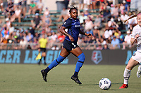 CARY, NC - SEPTEMBER 12: Taylor Smith #2 of the North Carolina Courage passes the ball during a game between Portland Thorns FC and North Carolina Courage at Sahlen's Stadium at WakeMed Soccer Park on September 12, 2021 in Cary, North Carolina.