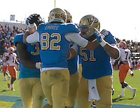 Taylor Embree of UCLA celebrates with his teammates after caught a touchdown pass during Kraft Bowl against Illinois at AT&T Park in San Francisco, California on December 31st, 2011.   Illinois defeated UCLA, 20-14.