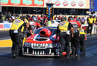 Jul. 26, 2013; Sonoma, CA, USA: NHRA Safety Safari members help crew members push pro stock driver V. Gaines back to the starting line after losing fire during qualifying for the Sonoma Nationals at Sonoma Raceway. Mandatory Credit: Mark J. Rebilas-