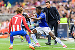 Wilfred Ndidi (r) of Leicester City fights for the ball with Antoine Griezmann of Atletico de Madrid during their 2016-17 UEFA Champions League Quarter-Finals 1st leg match between Atletico de Madrid and Leicester City at the Estadio Vicente Calderon on 12 April 2017 in Madrid, Spain. Photo by Diego Gonzalez Souto / Power Sport Images