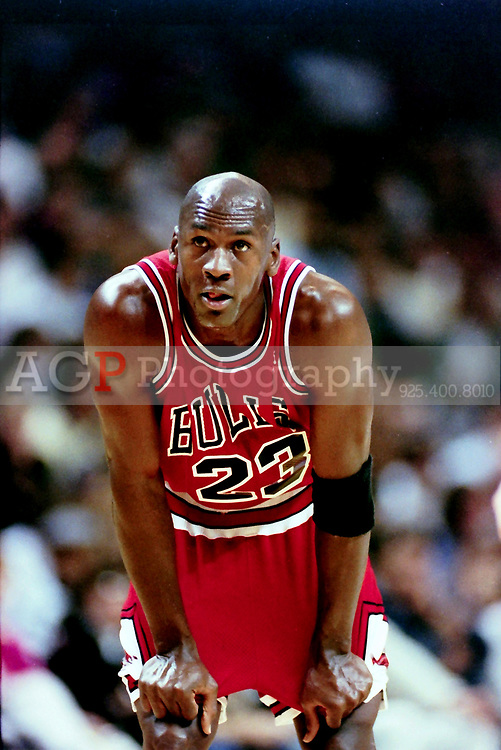 """NBA basketball great Michael Jordan on the court against the Golden State Warriors Wednesday November 20 1991. Jordan and the Bulls won the game 112-108. Jordan scored 35 points. Jordan played 15 seasons in the National Basketball Association (NBA) for the Chicago Bulls and Washington Wizards. His biography on the official NBA website states: """"By acclamation, Michael Jordan is the greatest basketball player of all time. (Photo by Alan Greth)"""