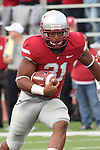 Washington State senior running back, Dwight Tardy (#31), packs the rock during the Cougars thrilling 30-27 overtime victory over SMU at Martin Stadium in Pullman, Washington, on September 19, 2009.