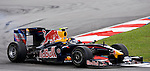 04 Apr 2009, Kuala Lumpur, Malaysia --- Red Bull Racing driver Sebastian Vettel of Germany steers his car during the third practice session ahead the 2009 Fia Formula One Malasyan Grand Prix at the Sepang circuit near Kuala Lumpur. Photo by Victor Fraile --- Image by © Victor Fraile / The Power of Sport Images