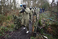 Pictured: Footballers in full gear, lead by Alan Tate walk through the muddy terrain. Tuesday 25 January 2011<br />