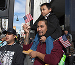 Resty and 3-year old Keoni during the Veterans Day Parade in downtown Reno on Saturday, Nov. 11, 2017.