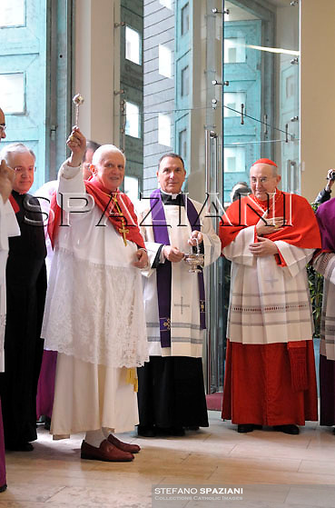 Pope Benedict XVI, second from right, celebrates a mass at the Holy face of Jesus parish church in Rome, Sunday March 29, 2009