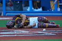 Catcher Ryan Shieh (14) of Bishop McNamara High School (MD) playing for the San Diego Padres scout team lies on the ground after having been hit by the ball during game three of the South Atlantic Border Battle at Truist Point on September 26, 2020 in High Pont, NC. (Brian Westerholt/Four Seam Images)