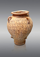 Minoan vase decorated with circle motif , Poros-Heraklion 1700-1450 BC,  Heraklion Archaeological  Museum, grey background