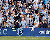 Brandon McDonald (4) of D.C. United goes up for a header with Aurelien Collin (78) of Sporting Kansas City during the game at Livestrong Sporting Park in Kansas City, Kansas.  D.C. United lost to Sporting Kansas City, 1-0.