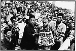 At a mass rally organized by rebels in Provincial People's Stadium, Party Secretary Wang Yilun and Li Xia, wife of Governor Li Fanwu are denounced, their faces and clothes splattered with ink, and their crimes spelled out on placards around their necks. Harbin, 29 August 1966