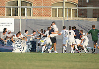 Players of Georgetown University surround Uche Oteqbeye #9 after his game winning goal during an NCAA match against Northeastern University at North Kehoe Field, Georgetown University on September 3 2010 in Washington D.C. Georgetown won 2-1 AET.