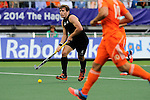 The Hague, Netherlands, June 10: Nick Haig #4 of New Zealand looks to pass during the field hockey group match (Men - Group B) between New Zealand and The Netherlands on June 10, 2014 during the World Cup 2014 at Kyocera Stadium in The Hague, Netherlands. Final score 1-1 (0-1) (Photo by Dirk Markgraf / www.265-images.com) *** Local caption ***