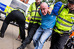 """© Joel Goodman - 07973 332324 . 22/08/2015 . Manchester , UK . A far-right protester is detained . Far-right nationalist group , """" North West Infidels """" and Islamophobic , anti-Semitic and white supremacist supporters , hold a rally in Manchester City Centre . Photo credit : Joel Goodman"""