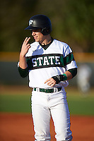 Chicago State Cougars designated hitter Cody Freund (9) signals to teammates after getting on base during a game against the Georgetown Hoyas on March 3, 2017 at North Charlotte Regional Park in Port Charlotte, Florida.  Georgetown defeated Chicago State 11-0.  (Mike Janes/Four Seam Images)