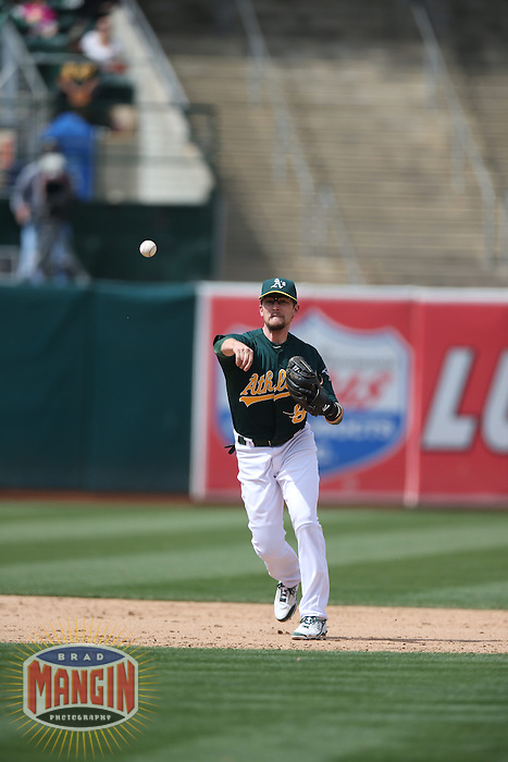OAKLAND, CA - MAY 15:  Jed Lowrie #8 of the Oakland Athletics makes a play at shortstop during the game against the Texas Rangers at O.co Coliseum on Wednesday May 15, 2013 in Oakland, California. Photo by Brad Mangin