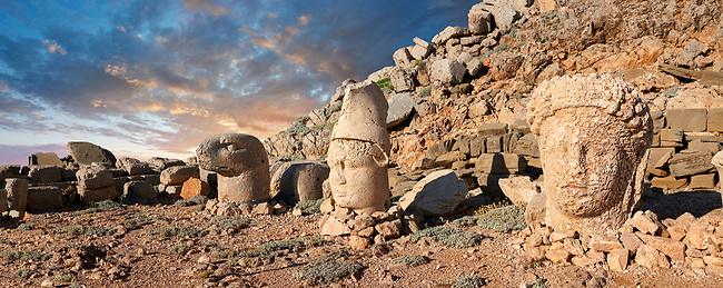 Statue heads at sunrise, from right, Commagene, Antiochus, & Eagle, with headless seated statues in front of the stone pyramid 62 BC Royal Tomb of King Antiochus I Theos of Commagene, east Terrace, Mount Nemrut or Nemrud Dagi summit, near Adıyaman, Turkey