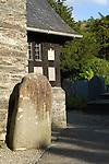 Maentwrog, Standing Stone outside porch of Parish Church. Gwynedd North Wales UK