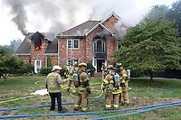 Firefighters battle a house fire blaze in Charlottesville, Va.