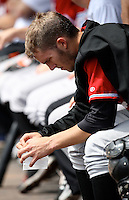 Norfolk Tides Starting Pitcher Brandon Erbe (33) sits in the dugout during a game vs. the Rochester Red Wings at Frontier Field in Rochester, New York;  June 3, 2010.   Rochester defeated Norfolk by the score of 9-0.  Photo By Mike Janes/Four Seam Images