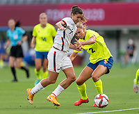 TOKYO, JAPAN - JULY 21: Tobin Heath #7 of the USWNT is defended by Jonna Andersson #2 of Sweden during a game between Sweden and USWNT at Tokyo Stadium on July 21, 2021 in Tokyo, Japan.