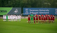 Pictured: Players and match officials observe a minute's silence in tribute to Swansea City FC's honorary president Gwilym Joseph who died age 90. Friday 11 August 2017<br /> Re: Premier League 2, Division 1, Swansea City U23 v Liverpool U23 at the Landore Training Ground, Swansea, UK