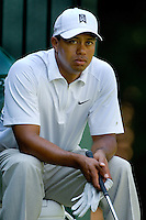 PGA golfer Tiger Woods waits to tee off while playing a round of golf with NBA legend Michael Jordan during the 2007 Wachovia Championships at Quail Hollow Country Club in Charlotte, NC.