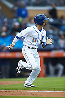 Andrew Velazquez (11) of the Durham Bulls hustles down the first base line against the Gwinnett Braves at Durham Bulls Athletic Park on April 20, 2019 in Durham, North Carolina. The Bulls defeated the Braves 11-3 in game one of a double-header. (Brian Westerholt/Four Seam Images)