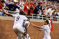 7 June 2011: USA Men's National Team forward Juan Agudelo (9) forward Jozy Altidore (17) and USA midfielder Landon Donovan (10) celebrate Jozy Altidore goal in the first half during the CONCACAF soccer match between Panama and Guadeloupe at Ford Field Detroit, Michigan.